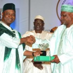 VICE PRESIDENT NAMADI SAMBO (L), PRESENTING A PUBLIC SERVICE CARER AWARD TO THE RETIRED HEAD OF CIVIL SERVICE OF THE FEDERATION, ALHAJI ISA BELLO  SALI (R), DURING 2013  CIVIL SERVICE DINNER AND AWARD NIGHT IN ABUJA ON SUNDAY  NIGHT.