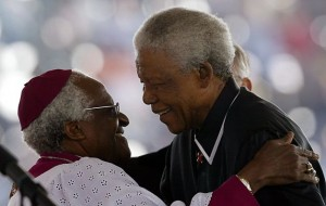 file photo: Desmond Tutu embraces Nelson Mandela