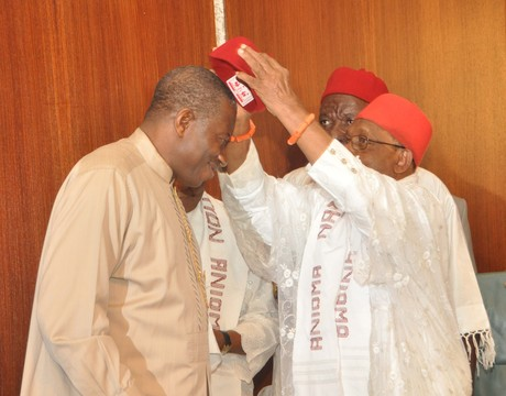 PRESIDENT GOODLUCK JONATHAN (L), BEING DECORATED WITH ANIOMA REGALIA BY ASAGBA OF ASABA, PROF. CHIKE EDOZIE, DURING THE VISIT OF ANIOMA TRADITIONAL RULERS AND ELDERS TO THE PRESIDENTIAL VILLA IN ABUJA, ON MONDAY