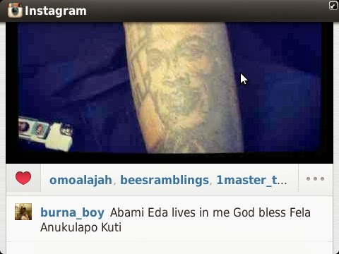 PHOTOS: Burna Boy Tattoos Fela On His Arm - Information Nigeria