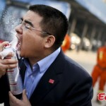 Chinese Businessmen Sprays Fire Extinguisher into His Mouth during Promotional Stunt