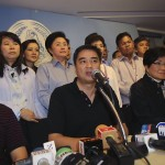 Democrat leader Abhisit Vejjajiva, center, with party members