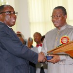 PRESIDENT GOODLUCK JONATHAN (R) RECEIVING HOLY BIBLE FROM THE DISTRICT SUPERINTENDENT, APOSTOLIC FAITH, WEST AND CENTRAL AFRICA, REVD. BAYO ADENIRAN DURING LAST SUNDAY OF THE YEAR CHURCH SERVICE AT APOSTOLIC FAITH CHURCH, REGIONAL HEADQUATERS JABI ABUJA ON SUNDAY (29/12/13).