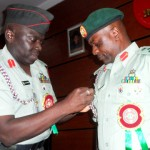 FORMER DIRECTOR, NIGERIAN ARMY PUBLIC RELATIONS, BRIG.-GEN. IBRAHIM ATTAHIRU (L), DECORATING HIS SUCCESSOR, BRIG.-GEN. OLAJIDE LALEYE, WITH THE BADGE OF THE DIRECTORATE DURING THE HAND-OVER CEREMONY IN ABUJA ON TUESDAY (7/1/14).