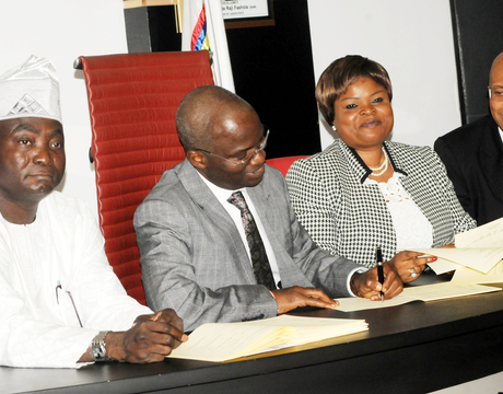 GOV. FASHOLA SIGNS 2014 BUDGET INTO LAW IN LAGOS PIC. 12.  FROM LEFT: DEPUTY SPEAKER, LAGOS HOUSE OF ASSEMBLY, MR KOLAWOLE TAIWO; GOV. BABATUNDE FASHOLA OF LAGOS; DEPUTY GOVERNOR, MRS ADEJOKE ORELOPE-ADEFULIRE AND COMMISSIONER FOR BUDGET AND PLANNING, MR BEN AKABUEZE, AT THE SIGNING OF 2014 BUDGET INTO LAW  IN LAGOS ON MONDAY(13/1/14).