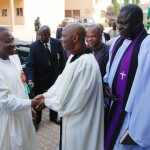 PRESIDENT GOODLUCK JONATHAN (L) BEING WELCOMED BY THE PRESIDENT, CHURCH OF CHRIST IN NATIONS GARKI ABUJA, REV. DACHOLLOM DATIRI AT THE CHURCH OF CHRIST IN NATIONS (COCIN) AREA 1 GARKI ABUJA FOR THE 1ST SUNDAY OF THE YEAR CHURCH SERVICE ON SUNDAY (5/1/14). RIGHT IS THE SERVICE LEADER, REV DAVID KWAMKUR.