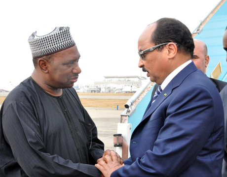 MINISTER OF STATE FOR WORKS, AMB. BASHIR YUGUDA (L), WELCOMING PRESIDENT MOHAMED ABDEL AZIZ OF MAURUTANIA ON HIS ARRIVAL AT THE NNAMDI AZIKIWE INTERNATIONAL AIRPORT FOR NIGERIA CENTENARY CELEBRATION IN ABUJA ON WEDNESDAY (26/2/14).