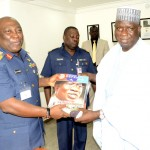 REP. ANTHONY MADWATTE RECEIVING A COPY OF DEFENCE MAGAZINE FROM THE CHIEF OF DEFENCE STAFF, AIR CHIEF MARSHAL ALEX BADEH, WHEN HE LED MEMBERS OF THE HOUSE OF REPRESENTATIVES FROM ADAMAWA ON A SOLIDARITY VISIT TO THE CDS IN ABUJA ON THURSDAY (6/4/14).
