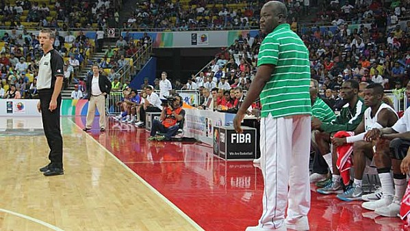Coach Ayo Bakare Watches D'Tigers' Match from the Touchline.