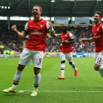 Lukas Podolski Scored a Brace as Arsenal Move Four Points Clear of Fourth-Placed Everton.