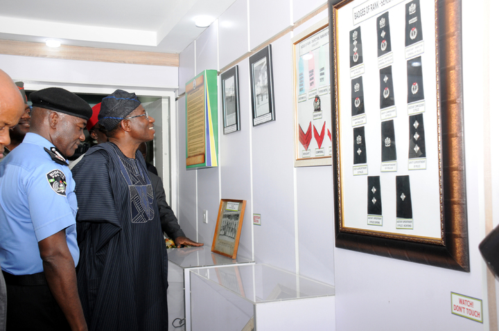 PRESIDENT GOODLUCK JONATHAN INSPECTING FACILITIES AT FORCE MUSEUM AFTER   INAUGURATION IN ABUJA ON TUESDAY (8/4/14) WITH HIM IS THE IGP MOHAMMED  ABUBAKAR.