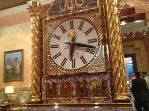 Gold clock the size of an armoire.