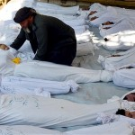 Corpses of victims of last year's gas attack in Damascus