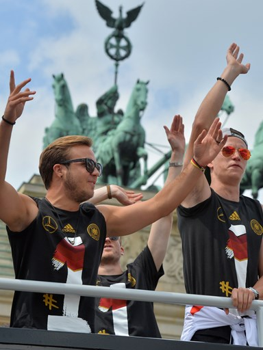 Mario Gotze (L) and Julian Draxler (R) on the Open-Top Bus. Image: AFP.