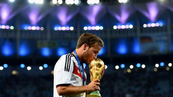 Mario Gotze Kisses The World Cup Trophy. Image: Fifa via Getty Image.