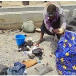 Graphic pics: Female ritualist caught with corpse of a 3yr old boy in Mile 2