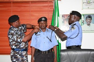 CP AMINCHI SAMAILA BARAYA BEING DECORATED WITH HIS NEW RANK BY THE IGP