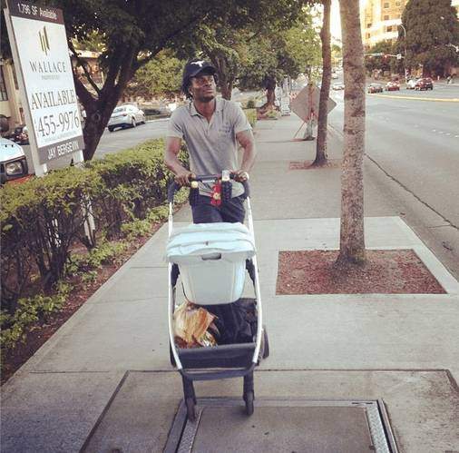 Photo: Obafemi Martins Takes A Stroll With His Son