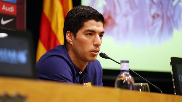 Luis Suarez Speaks to the Press at Barcelona's Camp Nou. Image: Twitter@FCBarcelona.
