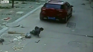 chi-terrifying-video-shows-suv-run-over-a-6yearold-boy-who-escapes-unharmed-20140825