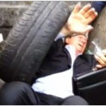 Not nice: Ex-minister thrown into rubbish bin by angry mob (photos)