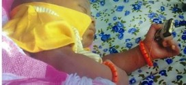 Photo: Baby born in Ibadan clutching holy Qur'an