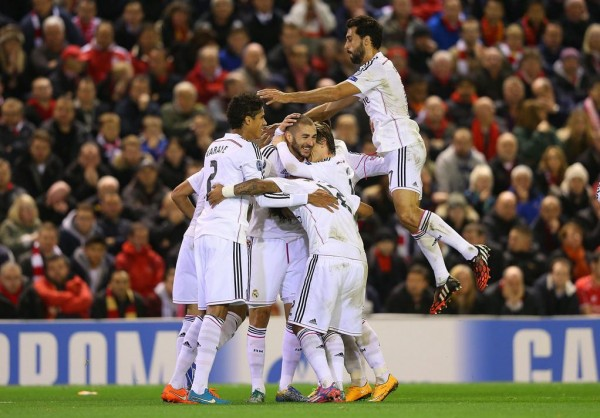 Karim Benzema Celebrates With His Team-Mates During Real Madrid's 3-0 Win at Anfield. Image: AFP/Getty.