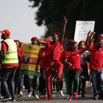 Supporters of Malema, expelled ANC youth leader and current leader of the EFF political party, chant slogans outside Polokwane High Court