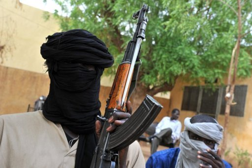 FILE PHOTO SHOWS FIGHTERS OF THE ISLAMIST GROUP MOVEMENT FOR ONENESS AND JIHAD IN WEST AFRICA (MUJAO) IN THE COURTYARD OF THE ISLAMIST POLICE STATION IN GAO, NORTHERN MALI, ON JULY 16, 2012.