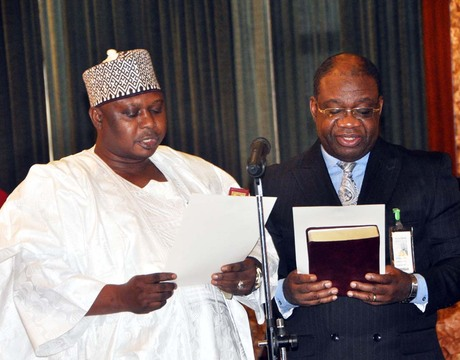 PROF. CHINEDU NEBO (R) WITH ALHAJI KABIRU TURAKI TAKING OATH OF OFFICE AS FEDERAL  MINISTERS BEFORE PRESIDENT GOODLUCK JONATHAN IN  ABUJA ON MONDAY
