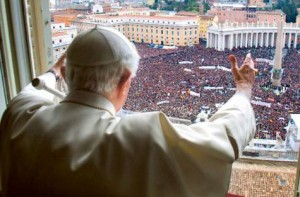 Pope Benedict acknowledges a packed St. Peter's Square beneath him after delivering the final Angelus devotion of his tenure as Pontiff on Sunday. Photo: EPA
