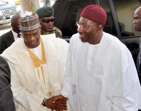 PRESIDENT GOODLUCK JONATHAN (R) BEING WELCOMED BY GOV. IBRAHIM  GEIDAM OF YOBE IN DAMATURU