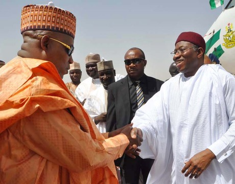 PRESIDENT GOODLUCK JONATHAN (R) BEING RECEIVED BY GOV.  KASHIM SHETTIMA OF BORNO IN MAIDUGURI DURING HIS VISIT TO BORNO  ON THURSDAY