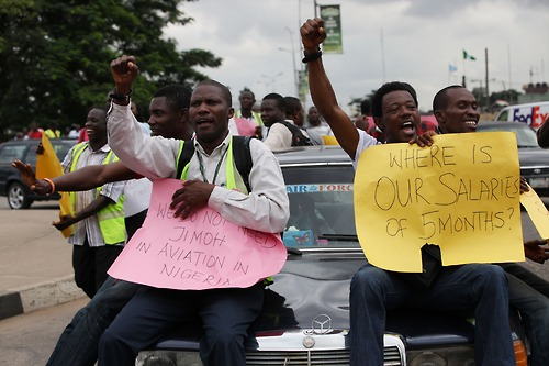 Staff of Air Nigeria airline protest after they were fired in Lagos, Nigeria, Friday, Sept. 7, 2012. Nigeria is facing major turmoil in its aviation industry, as one of its major air carriers has collapsed and fired nearly all its staff as other airlines have been grounded. More than 60 workers from Air Nigeria protested Friday at LagosÕ Murtala Muhammed International AirportÕs domestic wings, demanding four-months-worth of unpaid salaries from the company. The airlineÕs owner, business tycoon Jimoh Ibrahim, fired nearly all of the companyÕs 800 employees for ÒdisloyaltyÓ earlier this month. (AP Photo/Sunday Alamba)