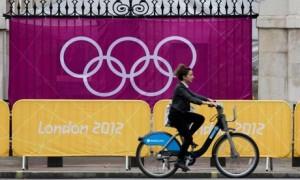Bike blog :   a woman rides  Barclays Bank-sponsored 'Boris' bicycle during London 2012 Olympics