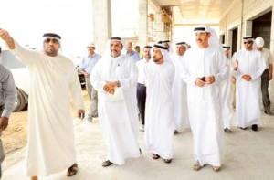 Eng. Hussain Nassir Lootah , Director General of Dubai Municipality showing officials round the new birds market