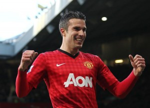 Robin van Persie of Manchester United celebrates scoring the opening goal of the game