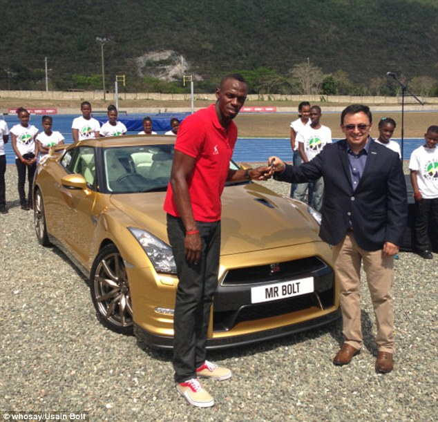 Usain Bolt and his Gold Coated Baby.