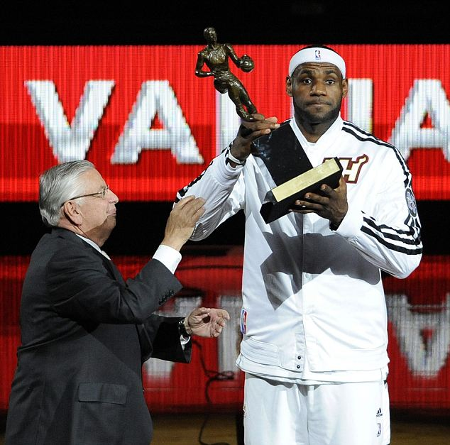 Commissioner David Stern (L) Hands LeBron 'King' James the MVP Trophy Before the Game.