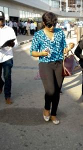 Omotola-arrives-in-Lagos-May-2013-BellaNaija009-332x600