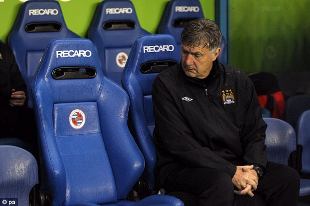Isn't Brian Kidd a Loner at the Visiting Stand of the Madjeski Stadium.