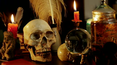 stock-footage-skull-witchcraft-desk-artifacts-hd-occult-study-setup-desk-with-a-skull-chandelier-candles