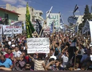 Demonstrators protest against Syria's President Bashar al-Assad after Friday prayers in Houla
