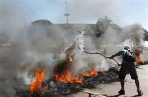 Protesters Burns Mounds Ahead of the Match Between Brazil and japan.