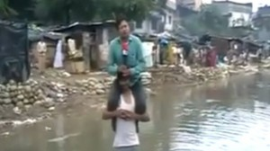 Photo: Indian Reporter Files Flood Report From Victim's Shoulder