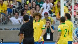 David Luiz Gets a Yellow For Pulling Down Skipper Diego Lugano in the Area.