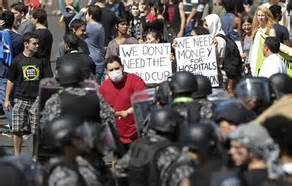 Protesters Held Placards while They Struggled With Police.