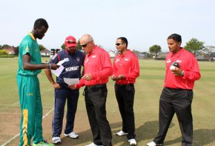 Captain Adegbola at the Coin Toss Before the Kuwait Match on Monday.