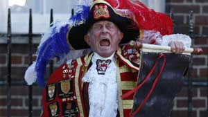 Tony Appleton, a town crier, announces the birth of the royal baby, outside St. Mary's Hospital exclusive Lindo Wing in London, on Monday. (Lefteris Pitarakis/Associated Press)