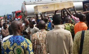 Traders mourn as bodies of their slain colleagues were brought back to Ibadan, Tuesday.
